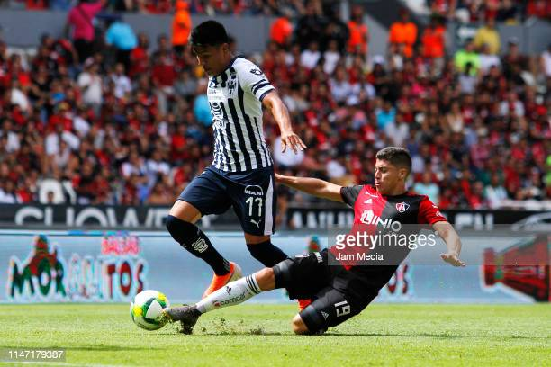 Jesus Gallardo of Monterrey and Esteban Carvajal of Atlas fight for the ball during the 17th round match between Atlas and Monterrey as part of the...