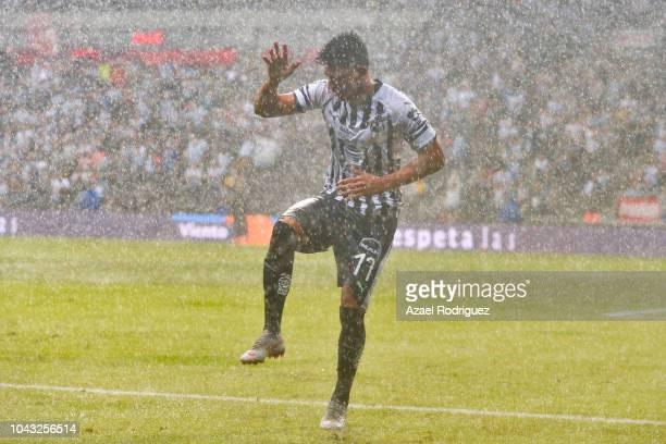 Jesus Gallardo of Monterrey dances under the rain after scoring his team's third goal during the 11th round match between Monterrey and Tijuana as...