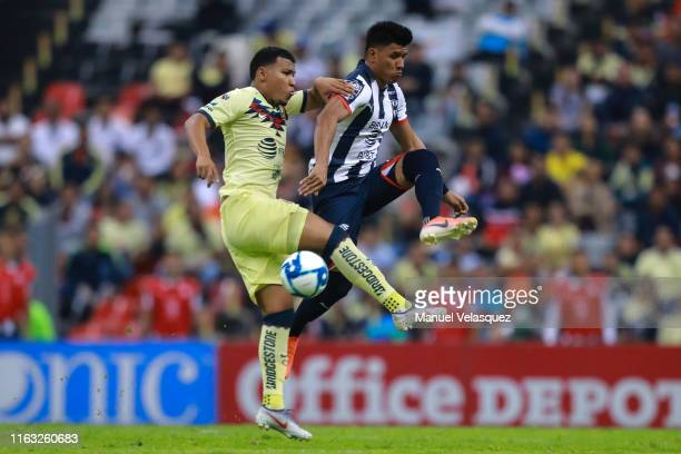 Jesus Gallardo of Monterrey struggles for the ball against Roger Martinez of America during the 1st round match between America and Monterrey as part...