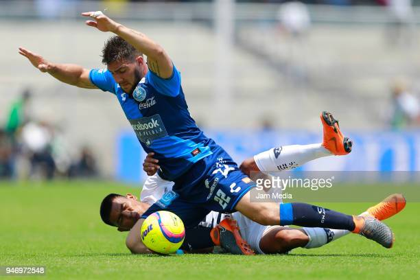Jesus Gallardo of Pumas and Lucas Cavallini of Puebla fight for the ball during the 15th round match between Pumas UNAM and Puebla as part of the...