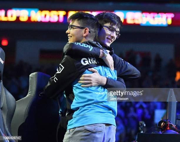 Jesus 'Gimmick' Parra of team Cloud9 hugs teammate Mariano 'SquishyMuffinz' Arruda after they defeated team Dignitas in the grand finals match of the...