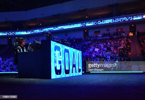 Jesus 'Gimmick' Parra of team Cloud9 scores during his team's grand finals match of the Rocket League Championship Series World Championship against...