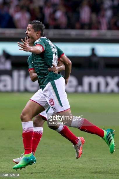Jesus Godinez of Chivas celebrates after scoring the first goal of his team during the 9th round match between Chivas and Pumas UNAM as part of the...