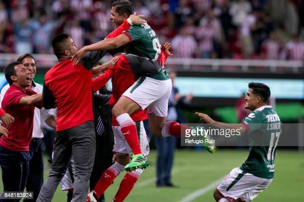 Jesus Godinez of Chivas celebrates with teammates after scoring the first goal of his team during the 9th round match between Chivas and Pumas UNAM...