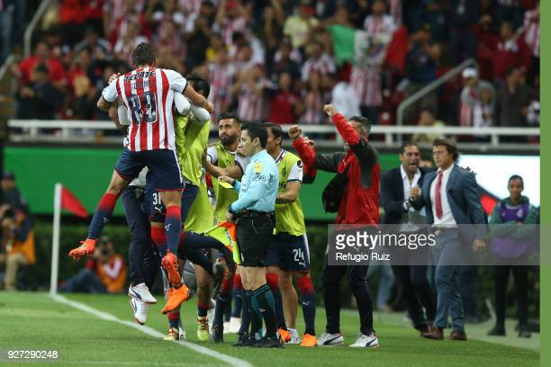 Jesus Godínez of Chivas celebrates after scoring the first goal of his team during the 10th round match between Chivas and America as part of the...