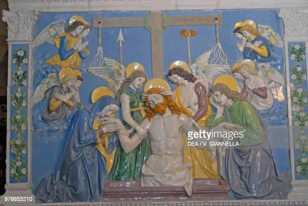Jesus in the sepulcher between the Virgin and St John glazed terracotta by Andrea Della Robbia La Verna sanctuary Chiusi della Verna Tuscany Italy...