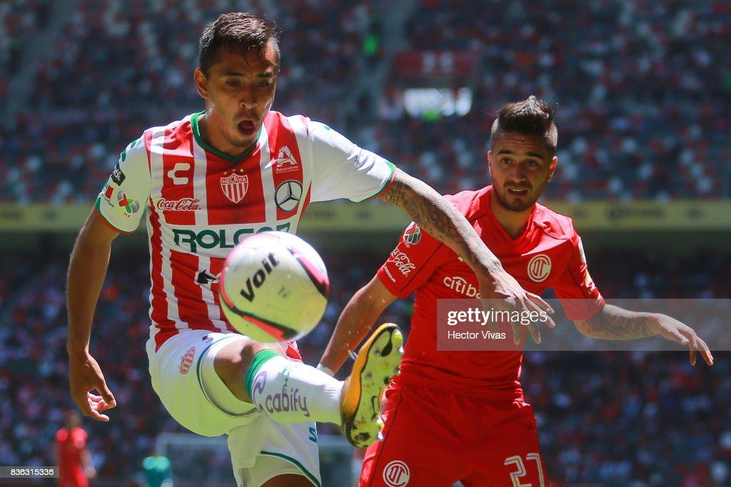 Jesus Isijara of Necaxa struggles for the ball with Rodrigo Gomez of Toluca during the fifth round match between Toluca and Necaxa as part of the Torneo Apertura 2017 Liga MX at Nemesio Diez Stadium on August 20, 2017 in Toluca, Mexico.