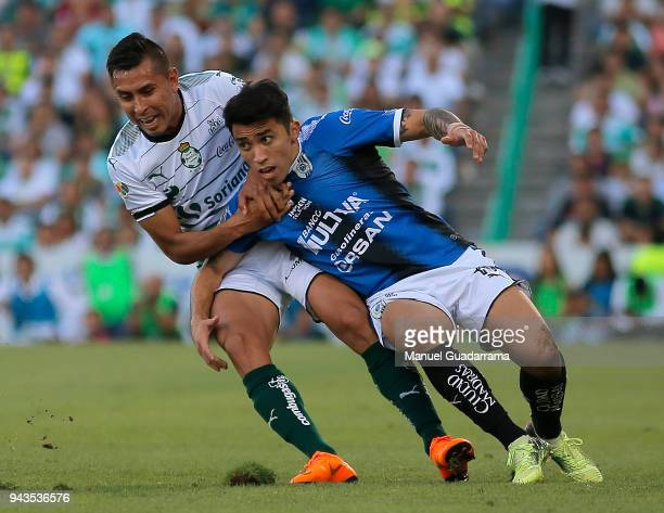 Jesus Isijara of Santos and Edson Puch of Qeretaro react during the 14th round match between Santos Laguna and Querataro as part of the Torneo...