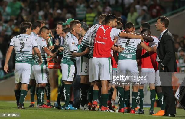 Jesus Isijara of Santos celebrates with teammates after scoring the first goal of his team during the 9th round match between Santos Laguna and Cruz...