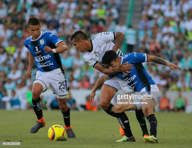 Jesus Isijara of Santos fights for the ball with Edson Puch of Qeretaro during the 14th round match between Santos Laguna and Querataro as part of...