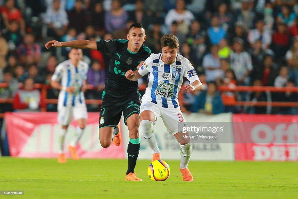 Jesus Isijara (L) of Santos struggles for the ball against Sebastian Palacios (R) of Pachuca during the 15th round match between Pachuca and Santos Laguna as part of the Torneo Clausura 2018 Liga MX at Hidalgo Stadium on April 14, 2018 in Pachuca, Mexico.