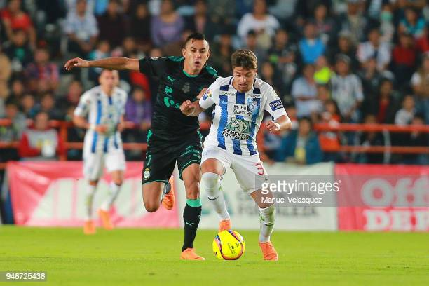 Jesus Isijara of Santos struggles for the ball against Sebastian Palacios of Pachuca during the 15th round match between Pachuca and Santos Laguna as...