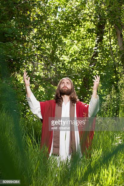 jesus lifting arms to the heavens - happy easter jesus stock photos and pictures