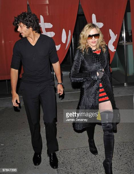 Jesus Luz and Madonna are seen leaving Morimoto in the Meatpacking District on March 18 2010 in New York City