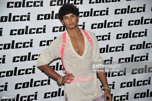 Jesus Luz poses for a photograf at Colcci during the first day of Sao Paulo Fashion Week SpringSummer 2010 collection at the Bienal Pavilion in...