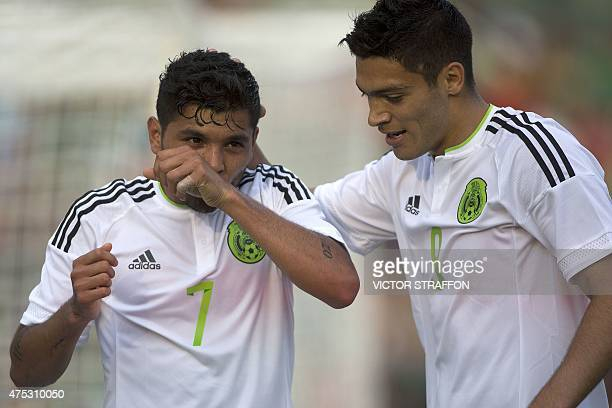 Jesus Manuel Corona of Mexico celebrates after scoring against Guatemala with teammate Raul Jimenez during their friendly football match at the...