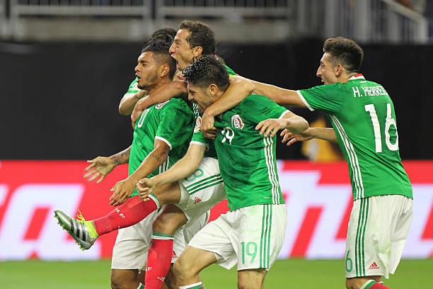 50a4765f2 Jesus Manuel Corona of Mexico celebrates with teammates after scoring the  first goal of his team