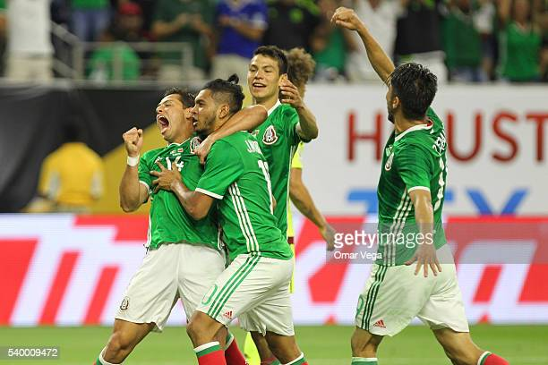 Jesus Manuel Corona of Mexico celebrates with teammates after scoring the first goal of his team during a group C match between Mexico and Venezuela...