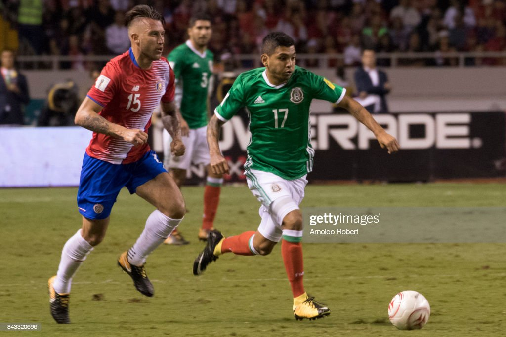 Jesus Manuel Corona of Mexico fights for the ball with Francisco Calvo of Costa Rica during the match between Costa Rica and Mexico as part of the FIFA 2018 World Cup Qualifiers at Nacional de Costa Rica Stadium on September 05, 2017 in San Jose, Costa Rica.