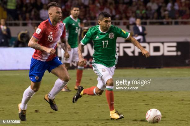 Jesus Manuel Corona of Mexico fights for the ball with Francisco Calvo of Costa Rica during the match between Costa Rica and Mexico as part of the...