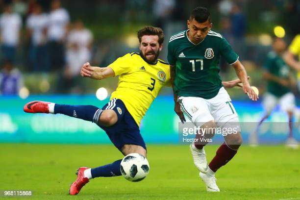 Jesus Manuel Corona of Mexico struggles for the ball with Graeme Shinnie of Scotland during the International Friendly match between Mexico v...