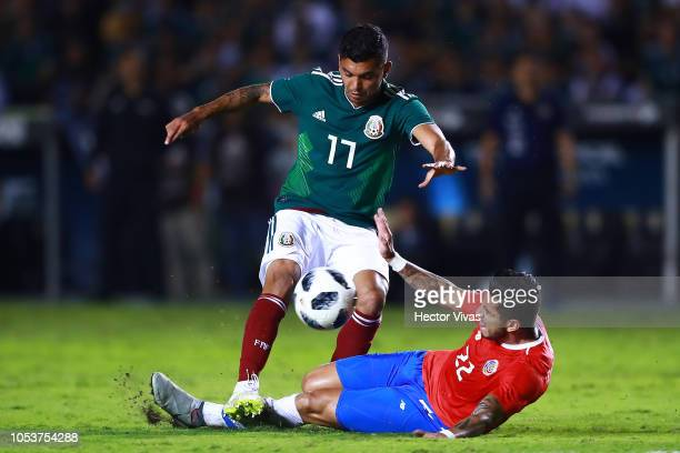 Jesus Manuel Corona of Mexico struggles for the ball with Ronald Matarrita of Costa Rica during the international friendly match between Mexico and...