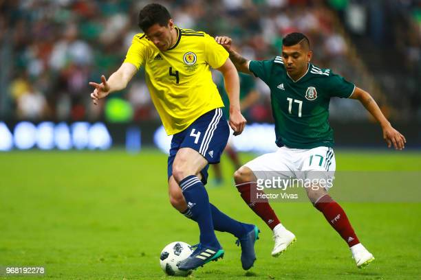 Jesus Manuel Corona of Mexico struggles for the ball with Scott McKenna of Scotland during the International Friendly match between Mexico v Scotland...