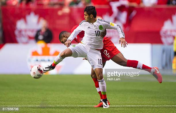 Jesus Manuel Corona of Mexico takes the ball away from Doneil Henry of Canada during FIFA 2018 World Cup Qualifier soccer action at BC Place on March...
