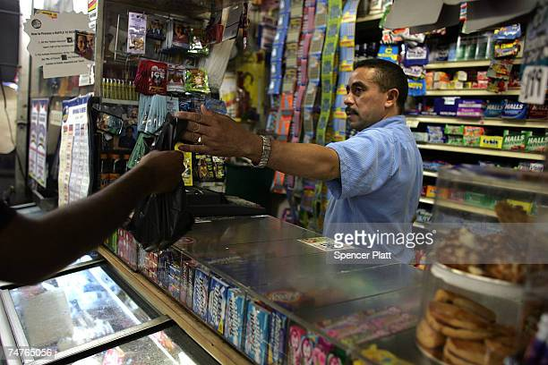 Jesus Martinez works at his bodega grocery store around the corner from where Bolivar Cruz was killed while working at his bodega last week June 18...