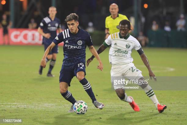 Jesus Medina of New York City controls the ball past Diego Chara of Portland Timbers during a quarter final match of MLS Is Back Tournament at ESPN...