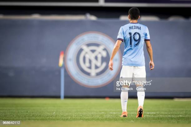 Jesus Medina of New York City with the NYCFC logo behind him during the MLS match between New York City FC and Orlando City SC at Yankee Stadium on...