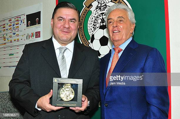 Jesus Mena director of the CONAD and Justino Compean president of the Mexican Football Federation pose for a photo during a visit to the FEMEXFUT on...