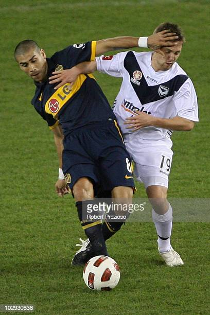 Jesus Mendez of the Boca Juniors and Evan Berger of the Melbourne Victory contest the ball during the preseason International Friendly between...
