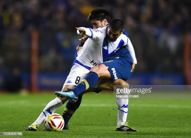 Jesus Mendez of Velez Sarsfield fights for the ball with Pablo Perez of Boca Juniors during a match between Boca Juniors and Velez as part of...