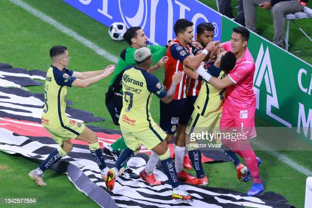 Jesus Molina and Raul Gudino of Chivas hold Henry Martin of America to avoid a confrontation while Miguel Ponce of Chivas puts a hand on Martin's...