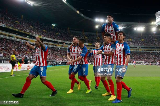 Jesus Molina of Chivas celebrates after scoring the first goal of his team during the 9th round match between Atlas and Chivas as part of the Torneo...