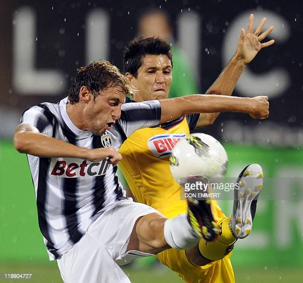 Jesus Molina of Club America and Claudio Marchiso of Juventus vie for the ball during their Herbalife World Football Challenge on July 26 2011 at...