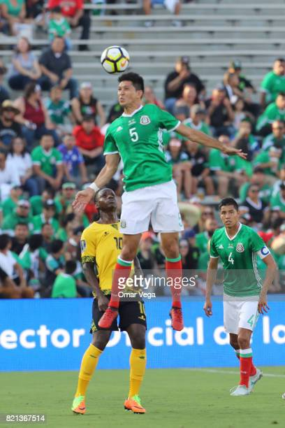 Jesus Molina of Mexico goes for a header during a match between Mexico and Jamaica as part of CONCACAF Gold Cup Semifinal at Rose Bowl Stadium on...