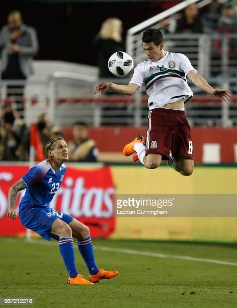 Jesus Molina of Mexico heads the ball away from Ari Skulason of Iceland at Levi's Stadium on March 23 2018 in Santa Clara California