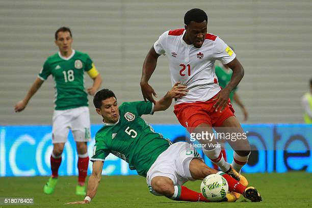 Jesus Molina of Mexico struggles for the ball with Cyle Larin of Canada during the match between Mexico and Canada as part of the FIFA 2018 World Cup...