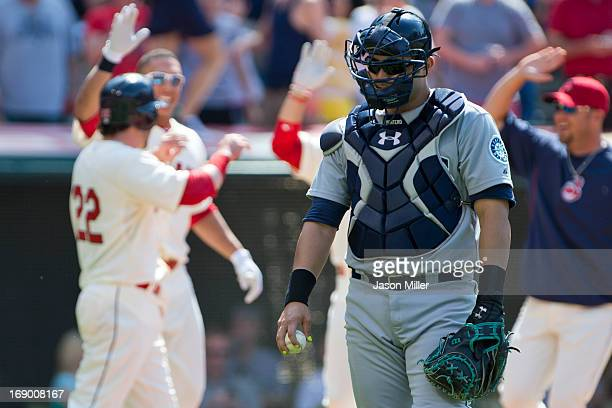 Jesus Montero of the Seattle Mariners walks off the field after he failed to keep his foot on the plate and allowing Jason Kipnis of the Cleveland...