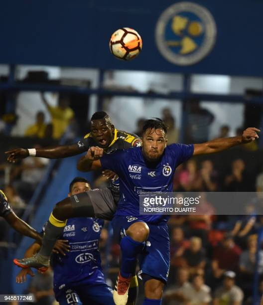 Jesus Murillo of Colombias Independiente de Medellin vies for the ball wies Federico Acuna of Paraguay's Sol de America during their 2018 Copa...