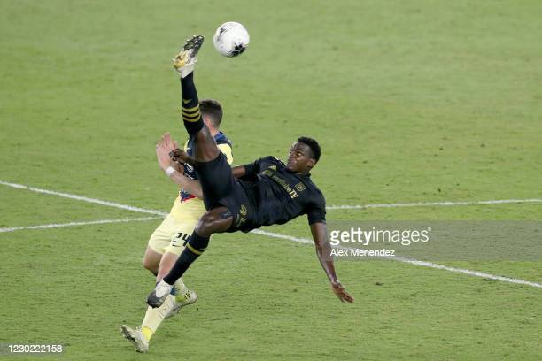 Jesus Murillo of Los Angeles FC clears the ball in front of Federico Vinas of Club America during the CONCACAF Champions League semifinal game at...