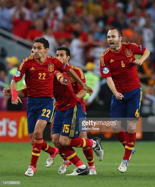 Jesus Navas and Andres Iniesta of Spain celebrate during the UEFA EURO 2012 semi final match between Portugal and Spain at Donbass Arena on June 27...