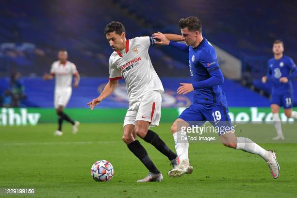 Jesus Navas of FC Sevilla and Mason Mount of Chelsea battle for the ball during the UEFA Champions League Group E stage match between Chelsea FC and...