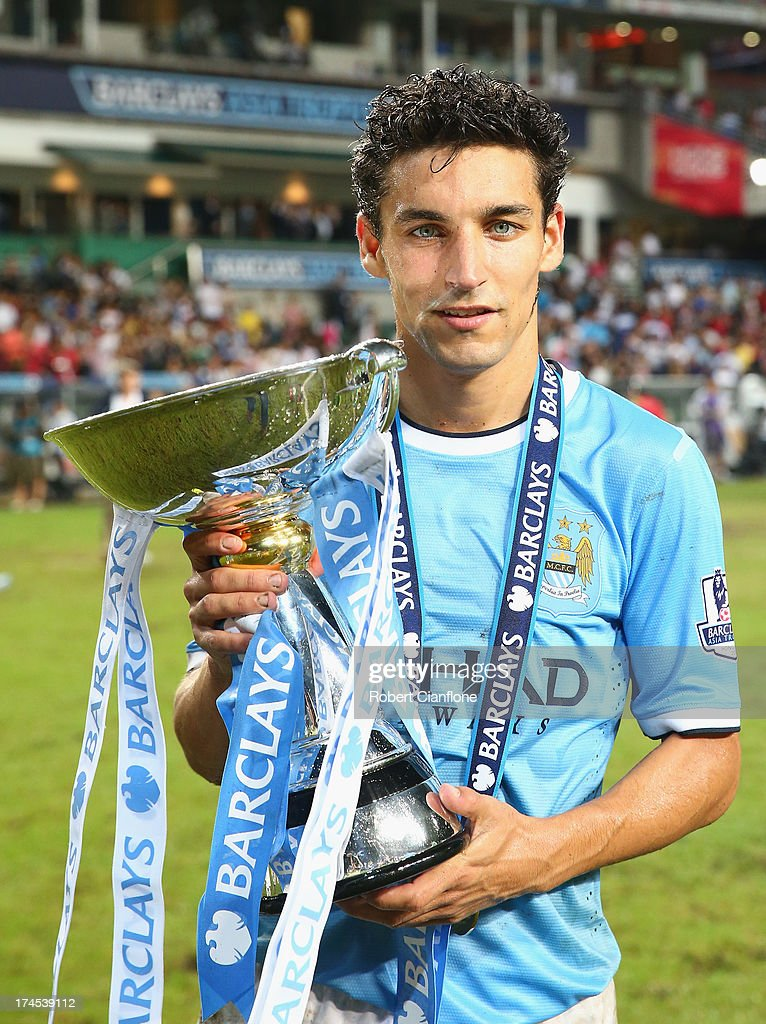 Jesus Navas of Mancester City holds the Asia trophy after Mancester City defeated Sunderland at the Barclays Asia Trophy Final match between Manchester City and Sunderland at Hong Kong Stadium on July 27, 2013 in So Kon Po, Hong Kong.