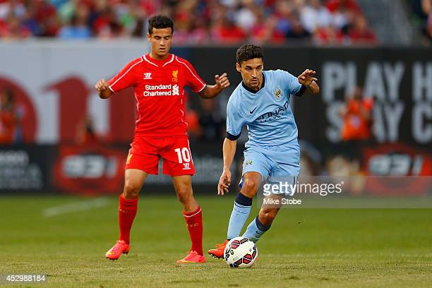 Jesus Navas of Manchester City in action against Philippe Coutinho of Liverpool during the International Champions Cup 2014 at Yankee Stadium on July...