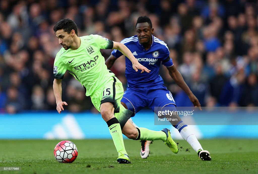 Jesus Navas of Manchester City in action with Baba Rahman of Chelsea during the Barclays Premier League match between Chelsea and Manchester City at Stamford Bridge on April 16, 2016 in London, England.