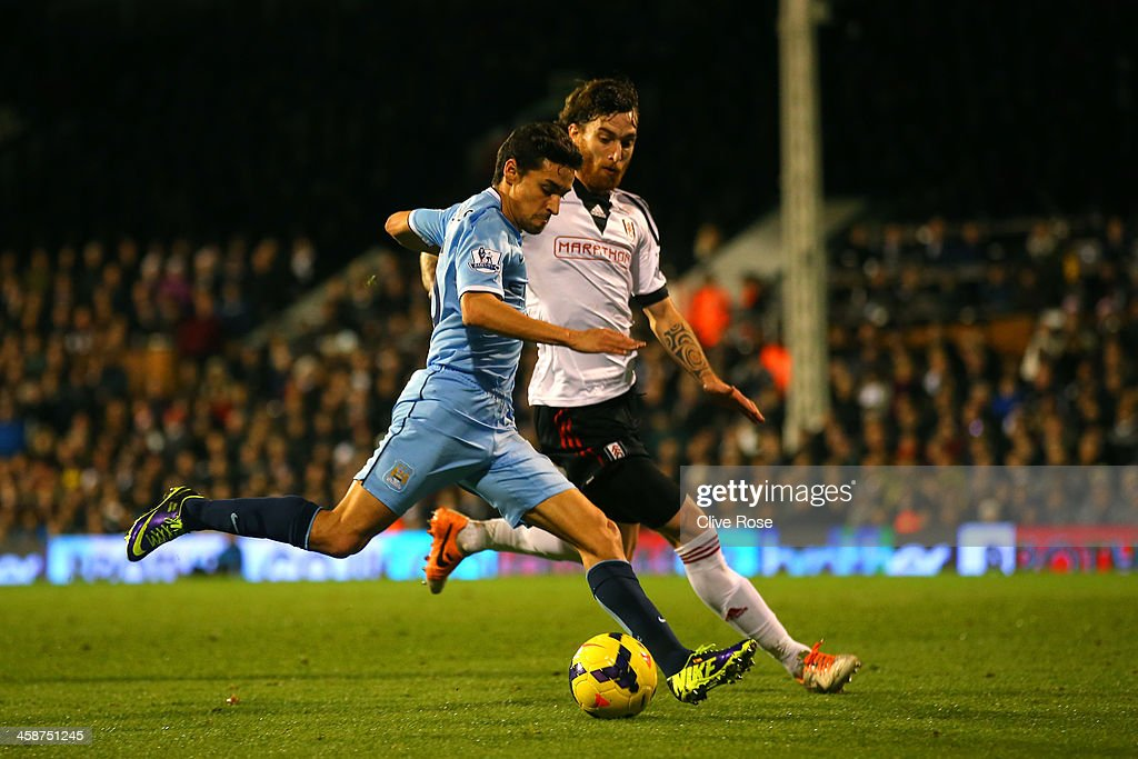 Jesus Navas of Manchester City scores the third goal during the Barclays Premier League match between Fulham and Manchester City at Craven Cottage on December 21, 2013 in London, England.