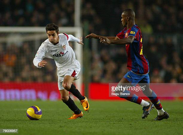 Jesus Navas of Sevilla and Abidal of Barcelona in action during the Copa del Rey match between FC Barcelona and Sevilla played at the Camp Nou...